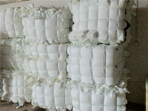 compressed bundles or bales of scrap foam