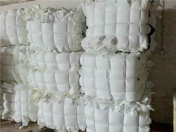 compressed bundles or bales of scrap foam