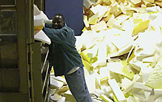 man bailing foam