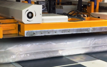 "A machine that compresses the mattress from 10"" to 1"" thick"