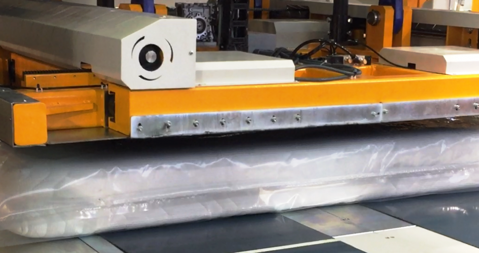 """A machine that compresses the mattress from 10"""" to 1"""" thick"""
