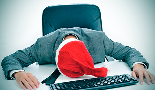 Man sleeping at work during the holidays